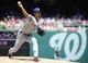 Jun 1, 2014; Washington, DC, USA; Texas Rangers starting pitcher Yu Darvish (11) throws during the first inning against the Washington Nationals at Nationals Park. Mandatory Credit: Brad Mills-USA TODAY Sports