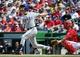Jun 1, 2014; Washington, DC, USA; Texas Rangers starting pitcher Yu Darvish (11) at bat against the Washington Nationals during the fifth inning at Nationals Park. The Rangers won 2-0. Mandatory Credit: Brad Mills-USA TODAY Sports