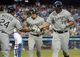 Jun 2, 2014; Los Angeles, CA, USA; Chicago White Sox first baseman Jose Abreu (79) is congratulated by left fielder Dayan Viciedo (24) and second baseman Gordon Beckham (15) after hitting a two-run home run in the fourth inning as Los Angeles Dodgers catcher Drew Butera (31) watches at Dodger Stadium. Mandatory Credit: Kirby Lee-USA TODAY Sports