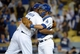 Jun 2, 2014; Los Angeles, CA, USA; Los Angeles Dodgers reliever Kenley Jansen (74) and catcher Drew Butera (31) embrace at the end of the game against the Chicago White Sox at Dodger Stadium. The Dodgers defeated the White Sox 5-2. Mandatory Credit: Kirby Lee-USA TODAY Sports