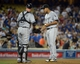 Jun 2, 2014; Los Angeles, CA, USA; Chicago White Sox pitcher Jose Quintana (right) and catcher Tyler Flowers (21) react in the sixth inning against the Los Angeles Dodgers at Dodger Stadium. The Dodgers defeated the White Sox 5-2. Mandatory Credit: Kirby Lee-USA TODAY Sports