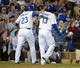 Jun 2, 2014; Los Angeles, CA, USA; Los Angeles Dodgers shortstop Hanley Ramirez (13) and first baseman Adrian Gonzalez (23) embrace after scoring in the sixth inning against the Chicago White Sox at Dodger Stadium. The Dodgers defeated the White Sox 5-2. Mandatory Credit: Kirby Lee-USA TODAY Sports