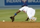 Jun 4, 2014; Los Angeles, CA, USA; Los Angeles Dodgers second baseman Dee Gordon (9) dives for a ball hit by Chicago White Sox starting pitcher John Danks (50) in the sixth inning of the game at Dodger Stadium. Mandatory Credit: Jayne Kamin-Oncea-USA TODAY Sports