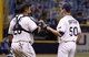Jun 6, 2014; St. Petersburg, FL, USA; Tampa Bay Rays catcher Jose Molina (28) and relief pitcher Grant Balfour (50) congratulate each other after they beat the Seattle Mariners at Tropicana Field. Tampa Bay Rays defeated the Seattle Mariners 4-0. Mandatory Credit: Kim Klement-USA TODAY Sports