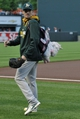 Jun 7, 2014; Baltimore, MD, USA; Oakland Athletics pitcher Dan Otero (61) wears a unicorn backpack as he heads to the bullpen prior to a game against the Baltimore Orioles at Oriole Park at Camden Yards. Mandatory Credit: Joy R. Absalon-USA TODAY Sports