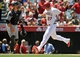 June 8, 2014; Anaheim, CA, USA; Los Angeles Angels center fielder Mike Trout (27) scores a run in the third inning against the Chicago White Sox at Angel Stadium of Anaheim. Mandatory Credit: Gary A. Vasquez-USA TODAY Sports