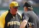 Jun 8, 2014; Pittsburgh, PA, USA; Pittsburgh Pirates manager Clint Hurdle (L) argues with home plate umpire Ed Hickox (R) after catcher Russell Martin (not pictured) was ejected against the Milwaukee Brewers during the eighth inning at PNC Park. The Brewers won 1-0. Mandatory Credit: Charles LeClaire-USA TODAY Sports