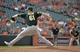 Jun 8, 2014; Baltimore, MD, USA; Oakland Athletics pitcher Dan Otero (61) pitches in the ninth inning against the Baltimore Orioles at Oriole Park at Camden Yards. The Athletics defeated the Orioles 11-1. Mandatory Credit: Joy R. Absalon-USA TODAY Sports