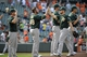 Jun 8, 2014; Baltimore, MD, USA; Oakland Athletics teammates Brandon Moss (right) and Ryan Cook (left) high-five after a game against the Baltimore Orioles at Oriole Park at Camden Yards. The Athletics defeated the Orioles 11-1. Mandatory Credit: Joy R. Absalon-USA TODAY Sports