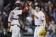 Jun 8, 2014; Detroit, MI, USA; Boston Red Sox catcher A.J. Pierzynski (left) and relief pitcher Koji Uehara (right) celebrate after the game against the Detroit Tigers at Comerica Park. Boston won 5-3. Mandatory Credit: Rick Osentoski-USA TODAY Sports