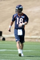 Jun 10, 2014; Denver, CO, USA; Denver Broncos quarterback Peyton Manning (18) during mini camp drills at the Broncos practice facility. Mandatory Credit: Ron Chenoy-USA TODAY Sports