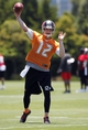 Jun 10, 2014; Tampa Bay, FL, USA; Tampa Bay Buccaneers quarterback Josh McCown (12) throws the ball as he works out during mini camp at One Buccaneer Place. Mandatory Credit: Kim Klement-USA TODAY Sports