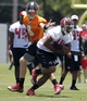 Jun 10, 2014; Tampa Bay, FL, USA;  Tampa Bay Buccaneers quarterback Mike Glennon (8) hands the ball off to running back Charles Sims (34) during mini camp at One Buccaneer Place. Mandatory Credit: Kim Klement-USA TODAY Sports