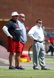 Jun 10, 2014; Tempe, AZ, USA; Arizona Cardinals head coach Bruce Arians (left), general manager Steve Keim (center) and president Michael Bidwill on the sidelines during mini camp at the teams Tempe training facility. Mandatory Credit: Mark J. Rebilas-USA TODAY Sports