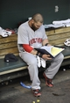 Jun 10, 2014; Baltimore, MD, USA; Boston Red Sox outfielder Jonny Gomes (5) looks over game charts prior to a game against the Baltimore Orioles at Oriole Park at Camden Yards. Mandatory Credit: Joy R. Absalon-USA TODAY Sports