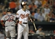 Jun 10, 2014; Baltimore, MD, USA; Baltimore Orioles second baseman Ryan Flaherty (3) reacts after striking out in the third inning against the Boston Red Sox at Oriole Park at Camden Yards. The Red Sox defeated the Orioles 1-0. Mandatory Credit: Joy R. Absalon-USA TODAY Sports