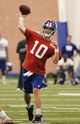 Jun 12, 2014; East Rutherford, NJ, USA; New York Giants quarterback Eli Manning (10) throws a pass during New York Giants minicamp at the Quest Diagnostics Training Center. William Perlman/The Star-Ledger-USA TODAY Sports