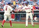 Jun 12, 2014; Philadelphia, PA, USA; Philadelphia Phillies right fielder Marlon Byrd (3) is congratulated by catcher Wil Nieves (21) after scoring a run during the fourth inning a game at Citizens Bank Park. Mandatory Credit: Bill Streicher-USA TODAY Sports