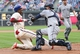 Jun 12, 2014; Philadelphia, PA, USA; San Diego Padres catcher Yasmani Grandal (8) tags out Philadelphia Phillies first baseman John Mayberry Jr. (15) at home plate during the fourth inning of a game at Citizens Bank Park. Mandatory Credit: Bill Streicher-USA TODAY Sports