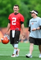 Jun 12, 2014; Berea, OH, USA; Cleveland Browns quarterback Johnny Manziel talks with quarterbacks coach Dowell Loggains during minicamp at Browns training facility. Mandatory Credit: Andrew Weber-USA TODAY Sports