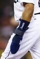 Jun 7, 2014; Detroit, MI, USA; Sliding glove of Detroit Tigers left fielder Rajai Davis (20) during the game against the Boston Red Sox at Comerica Park. Mandatory Credit: Rick Osentoski-USA TODAY Sports