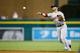 Jun 8, 2014; Detroit, MI, USA; Boston Red Sox second baseman Dustin Pedroia (15) makes a throw against the Detroit Tigers at Comerica Park. Mandatory Credit: Rick Osentoski-USA TODAY Sports