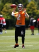Jun 10, 2014; Tampa Bay, FL, USA; Tampa Bay Buccaneers quarterback Josh McCown (12) throws the ball as he works out for mini camp at One Buccaneer Place. Mandatory Credit: Kim Klement-USA TODAY Sports
