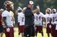 Jun 17, 2014; Ashburn, VA, USA; Washington Redskins head coach Jay Gruden demonstrates a pass route to Redskins wide receiver DeSean Jackson (1) during minicamp at Redskins Park. Mandatory Credit: Geoff Burke-USA TODAY Sports