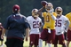Jun 17, 2014; Ashburn, VA, USA; Washington Redskins quarterback Robert Griffin III (10) throws the ball as Redskins head coach Jay Gruden (left) chases during minicamp at Redskins Park. Mandatory Credit: Geoff Burke-USA TODAY Sports