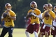 Jun 17, 2014; Ashburn, VA, USA; Washington Redskins quarterback Colt McCoy (16), Redskins quarterback Robert Griffin III (10), and Redskins quarterback Kirk Cousins (8) participate in drills during minicamp at Redskins Park. Mandatory Credit: Geoff Burke-USA TODAY Sports