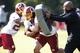 Jun 17, 2014; Ashburn, VA, USA; Washington Redskins running back Roy Helu (29) carries the ball through tackling pads during minicamp at Redskins Park. Mandatory Credit: Geoff Burke-USA TODAY Sports