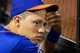 Jun 13, 2014; New York, NY, USA; New York Mets shortstop Wilmer Flores (4) looks on from the dugout during the fourth inning of a game against the San Diego Padres at Citi Field. The Mets defeated the Padres 6-2. Mandatory Credit: Brad Penner-USA TODAY Sports