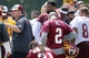 Jun 17, 2014; Ashburn, VA, USA; Washington Redskins head coach Jay Gruden (left) talks to his team in a huddle after a minicamp session at Redskins Park. Mandatory Credit: Geoff Burke-USA TODAY Sports