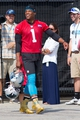 Jun 17, 2014; Charlotte, NC, USA; Carolina Panthers quarterback Cam Newton walks to the field prior to the start of the minicamp held at the Carolina Panthers practice facility. Mandatory Credit: Jeremy Brevard-USA TODAY Sports