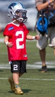 Jun 17, 2014; Charlotte, NC, USA; Carolina Panthers fan George Gring follows Cam Newton (not pictured) onto the practice field at the Carolina Panthers practice facility. Gring was drafted by the Panthers through the Make-A-Wish foundation. Mandatory Credit: Jeremy Brevard-USA TODAY Sports