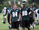 Jun 17, 2014; Philadelphia, PA, USA; Wide receivers Will Murphy (84) and Ifeanyi Momah (80) walk off the field at the conclusion of mini camp at the Philadelphia Eagles NovaCare Complex. Mandatory Credit: Bill Streicher-USA TODAY Sports