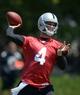 Jun 17, 2014; Alameda, CA, USA; Oakland Raiders quarterback Derek Carr (4) throws a pass at minicamp at Raiders Practice Facility. Mandatory Credit: Kirby Lee-USA TODAY Sports