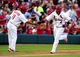 Jun 17, 2014; St. Louis, MO, USA; St. Louis Cardinals catcher Yadier Molina (4) is congratulated by third base coach Jose Oquendo (11) after hitting a solo home run off of New York Mets starting pitcher Jonathon Niese (not pictured) during the second inning at Busch Stadium. Mandatory Credit: Jeff Curry-USA TODAY Sports