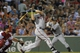 Jun 17, 2014; Boston, MA, USA; Minnesota Twins first baseman Joe Mauer (7) hits an RBI double during the sixth inning against the Boston Red Sox at Fenway Park. Mandatory Credit: Bob DeChiara-USA TODAY Sports