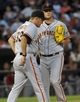 Jun 17, 2014; Chicago, IL, USA; San Francisco Giants starting pitcher Matt Cain (18)  and pitching coach Dave Righetti (33) talk after the White Sox scored in the fifth inning at U.S Cellular Field. Mandatory Credit: Matt Marton-USA TODAY Sports