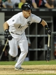 Jun 17, 2014; Chicago, IL, USA; Chicago White Sox second baseman Gordon Beckham (15) runs after hitting to left field in the fifth inning against the San Francisco Giants at U.S Cellular Field. Mandatory Credit: Matt Marton-USA TODAY Sports