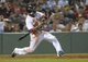 Jun 17, 2014; Boston, MA, USA; Boston Red Sox second baseman Dustin Pedroia (15) singles during the eighth inning against the Minnesota Twins at Fenway Park. Mandatory Credit: Bob DeChiara-USA TODAY Sports