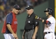 Jun 17, 2014; Boston, MA, USA; Boston Red Sox manager John Farrell (53) and second baseman Dustin Pedroia (15) argue a call with second base umpire Tm Welke during the eighth inning at Fenway Park. Mandatory Credit: Bob DeChiara-USA TODAY Sports