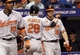 Jun 17, 2014; St. Petersburg, FL, USA; Baltimore Orioles first baseman Steve Pearce (28) is congratulated by first baseman Chris Davis (19) and teammates after he hit a 2-run home run during the seventh inning against the Tampa Bay Rays at Tropicana Field. Mandatory Credit: Kim Klement-USA TODAY Sports
