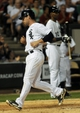 Jun 17, 2014; Chicago, IL, USA; Chicago White Sox third baseman Conor Gillaspie (12) scores on a designated hitter Adam Dunn (44) single  in the sixth inning against the San Francisco Giants at U.S Cellular Field. Mandatory Credit: Matt Marton-USA TODAY Sports