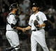 Jun 17, 2014; Chicago, IL, USA; Chicago White Sox relief pitcher Daniel Webb (40) and catcher Tyler Flowers (21) celebrate after beating the San Francisco Giants 8-2 at U.S Cellular Field. Mandatory Credit: Matt Marton-USA TODAY Sports