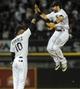Jun 17, 2014; Chicago, IL, USA; Chicago White Sox shortstop Alexei Ramirez (10) and center fielder Adam Eaton (1) celebrate after beating the San Francisco Giants 8-2 at U.S Cellular Field. Mandatory Credit: Matt Marton-USA TODAY Sports