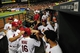 Jun 17, 2014; St. Louis, MO, USA; St. Louis Cardinals pinch hitter Kolten Wong (16) is congratulated by teammates after driving in a run during the sixth inning against the New York Mets at Busch Stadium. The Cardinals defeated the Mets 5-2. Mandatory Credit: Jeff Curry-USA TODAY Sports