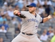 Jun 18, 2014; Bronx, NY, USA; Toronto Blue Jays starting pitcher Mark Buehrle throws a pitch against the New York Yankees in the first inning during the MLB baseball game at Yankee Stadium. Mandatory Credit: Robert Deutsch-USA TODAY Sports