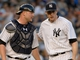 Jun 18, 2014; Bronx, NY, USA; New York Yankees starting pitcher Chase Whitley (right) talks with catcher Brian McCann (left) during the MLB baseball game against the Toronto Blue Jays at Yankee Stadium. Mandatory Credit: Robert Deutsch-USA TODAY Sports